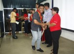 Officials and City PESO Manager Ms. Nilda A. Garcia congratulate 1 of the 21 graduates of the 6th Batch of the Skilled Workers English Enhancement Program (SWEEP) last April 11, 2013 at UM Tagum Campus. The said program and will then undergo an intensive review for the IELTS Exam. Photo by Leo Timogan of CIO Tagum