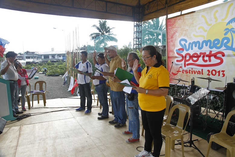 The new set of officers for the year 2013 of the Tagum City Federation of Sports Association led by its newly elected President Ma. Vilma J. Manulat taking their oath, which administered by Hon. Councilor Oscar Bermudez. Photo by Louie Lapat of CIO Tagum