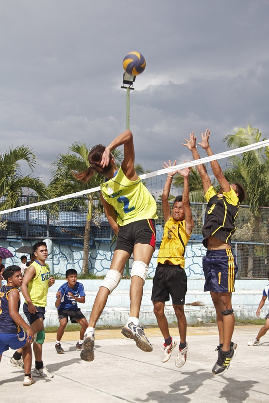 The actions spike captured at the 6-men volleyball game during the 5th Sports Summer Festival in Tagum City, which was participated with the sports enthusiasts coming from the different places in Davao region. Photo by Leo Timogan of CIO Tagum